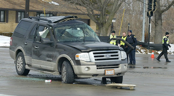 Police investigate the scene following an accident between a semi-truck and a Ford SUV at Kreutzer Road and Route 47 in Huntley. Flight for Life transported one woman to Condell Medical Center in Libertyville. H. Rick Bamman - hbamman@shawmedia.com