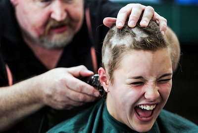 Sarah Nader- snader@shawmedia.com Sarah Richter, 17, of Lake in the Hills has her head shaved while participating in the Crystal Lake South Kiwanis 'KEY CLUB' ShaveAthon for St. Baldrick's Day in Crystal Lake Thursday, March 13, 2014. 44 students and facility raised over $10,000 for childhood cancer research at the event.