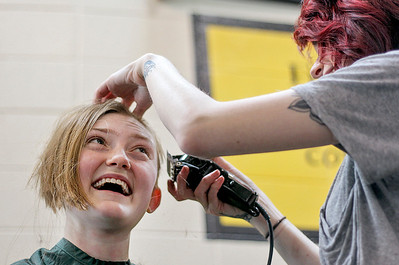 Sarah Nader- snader@shawmedia.com Kristin Knudsen, 17, of Crystal Lake has her head shaved while participating in the Crystal Lake South Kiwanis 'KEY CLUB' ShaveAthon for St. Baldrick's Day in Crystal Lake Thursday, March 13, 2014. 44 students and facility raised over $10,000 for childhood cancer research at the event. Knudsen raised over $1600.