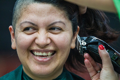 Kyle Grillot - kgrillot@shawmedia.com   Irene Puga of Woodstock reacts while she has her head shaved participating in the McHenry Community Shave for St. Baldrick's Day in McHenry Thursday, March 13, 2014. Over the past five years, McHenry East and West staff, students, and community members have had over 1900 heads shaved and raised over $489,000 for the St. Baldrick's Foundation.