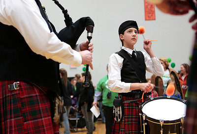 Kyle Grillot - kgrillot@shawmedia.com   Olivia Williams, 13, of the Dundee Scottish band performs at the McHenry Community Shave for St. Baldrick's Day in McHenry Thursday, March 13, 2014. Over the past five years, McHenry East and West staff, students, and community members have had over 1900 heads shaved and raised over $489,000 for the St. Baldrick's Foundation.