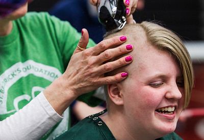 Kyle Grillot - kgrillot@shawmedia.com   Emma Becker of Johnsburg has her head shaved participating in the McHenry Community Shave for St. Baldrick's Day in McHenry Thursday, March 13, 2014. Over the past five years, McHenry East and West staff, students, and community members have had over 1900 heads shaved and raised over $489,000 for the St. Baldrick's Foundation.