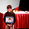 Ayumu Seiya, a student at Wredling Middle School in St. Charles, spells a word during the 2014 Kane County Spelling Bee Thursday at the Pheasant Run Resort Main Stage in St. Charles. Seiya was first runner-up in the event.