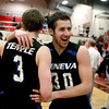 Geneva's Chris Parilli (30) celebrates with teammate Pace Temple following their IHSA 4A East Aurora sectional win over West Aurora Wednesday