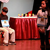 Anika Patel, a student at Cambridge Lakes Charter School in Gilberts, spells a word as Wredling Middle School student Ayumu Seiya waits his turn during the 2014 Kane County Spelling Bee Thursday at the Pheasant Run Resort Main Stage in St. Charles.