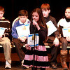 Charlline Rivera, a student at Kaneland McDole Elementary School, spells a word during the 2014 Kane County Spelling Bee Thursday at the Pheasant Run Resort Main Stage in St. Charles.