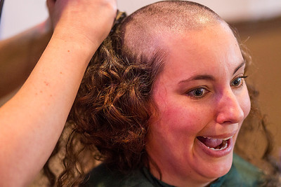 Kyle Grillot - kgrillot@shawmedia.com   Lori Sweet of Woodstock reacts as she looks to friends while participating in the Woodstock High School St. Baldrick's Day event Friday, March 14, 2014. Sweet raised $815 dollars for the foundation.