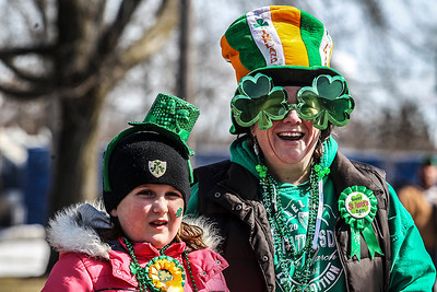 Sarah Nader- snader@shawmedia.com Dressed in St. Patrick's Day gear, Kiara Kearns (left), 8, of McHenry and her mother, Lisa, watch the annual St. Patrick's Day Parade hosted by the Rotary Club of McHenry Sunday, March 16, 2014. The parade was held  create awareness of and show support for the volunteer-run organizations that exist in the McHenry area.