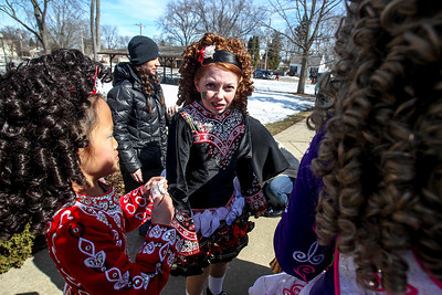 Sarah Nader- snader@shawmedia.com Megan Larkin (center), 11, of McHenry tries to warm up before performing an Irish dance with students from the McCormack Fay Academy of Irish Dance after the McHenry St. Patrick's Day parade at Veterans Memorial Park Sunday, March 16, 2014.