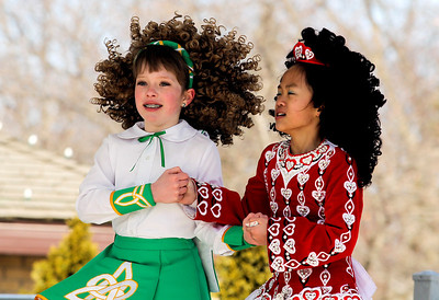 Sarah Nader- snader@shawmedia.com Sidney Green (left), 10, of Woodstock and Mei Cornell, 10, of Woodstock perform an Irish dance with students from the McCormack Fay Academy of Irish Dance after the McHenry St. Patrick's Day parade at Veterans Memorial Park Sunday, March 16, 2014.