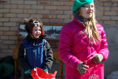 Sarah Nader- snader@shawmedia.com Connor Dencs, 4, of McHenry waits for candy to be thrown during the annual St. Patrick's Day Parade in McHenry hosted by the Rotary Club of McHenry Sunday, March 16, 2014. The parade was held to create awareness of and show support for the volunteer-run organizations that exist in the McHenry area.