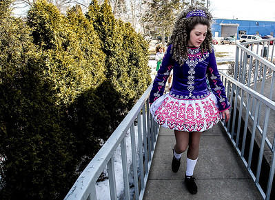 Sarah Nader- snader@shawmedia.com Ellie Stroh, 15, of Woodstock walks to the stage before performing an Irish dance with students from the McCormack Fay Academy of Irish Dance after the McHenry St. Patrick's Day parade at Veterans Memorial Park Sunday, March 16, 2014.