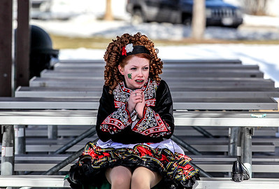 Sarah Nader- snader@shawmedia.com Megan Larkin, 11, of McHenry tries to warm up before performing an Irish dance with students from the McCormack Fay Academy of Irish Dance after the McHenry St. Patrick's Day parade at Veterans Memorial Park Sunday, March 16, 2014.