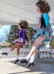 Sarah Nader- snader@shawmedia.com Ellie Stroh (left), 15, of Woodstock and Molly Dougherty, 17, of Woodstock perform an Irish dance with students from the McCormack Fay Academy of Irish Dance after the McHenry St. Patrick's Day parade at Veterans Memorial Park Sunday, March 16, 2014.