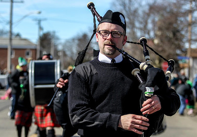 Sarah Nader- snader@shawmedia.com Adam Parchert of Carpentersville plays the bag pipe with the Dundee Scottish Pipe Band during the annual St. Patrick's Day Parade in McHenry hosted by the Rotary Club of McHenry Sunday, March 16, 2014. The parade was held to create awareness of and show support for the volunteer-run organizations that exist in the McHenry area.