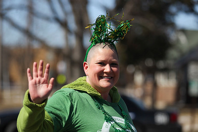 Sarah Nader- snader@shawmedia.com Amanda Wilkins of Wonder Lake walks in the annual St. Patrick's Day Parade in McHenry hosted by the Rotary Club of McHenry Sunday, March 16, 2014. The parade was held to create awareness of and show support for the volunteer-run organizations that exist in the McHenry area.