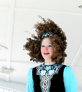 Sarah Nader- snader@shawmedia.com Molly Dougherty, 17, of Woodstock performs an Irish dance with students from the McCormack Fay Academy of Irish Dance after the McHenry St. Patrick's Day parade at Veterans Memorial Park Sunday, March 16, 2014.