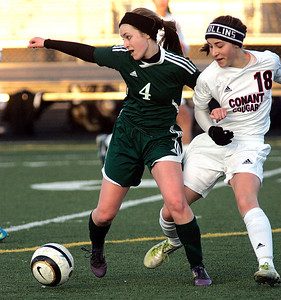 Joseph Cyganowski - For Shaw Media Erin Woeste, left is tied up by Emily Mazurek, right.The Gators of Crystal Lake South High School, opened the soccer season,  travelling to Conant High School in Hoffman Estates to  battle the Cougars,  Monday, March 17, 2014.