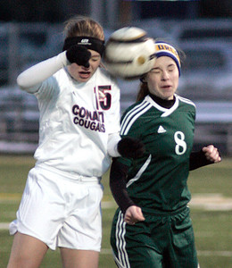 Joseph Cyganowski - For Shaw Media Marisa Dizonno, left goes to the air with Elizabeth Massat, right.The Gators of Crystal Lake South High School, opened the soccer season,  travelling to Conant High School in Hoffman Estates to  battle the Cougars,  Monday, March 17, 2014.