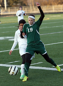 Joseph Cyganowski - For Shaw Media Dhara Patel, left is cut off from the ball by Alexandra Siavelis, right.The Gators of Crystal Lake South High School, opened the soccer season,  travelling to Conant High School in Hoffman Estates to  battle the Cougars,  Monday, March 17, 2014.