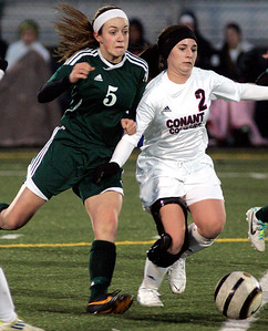 Joseph Cyganowski - For Shaw Media Jenna Ross, left, pressures Sidney O'keeffe, right.The Gators of Crystal Lake South High School, opened the soccer season,  travelling to Conant High School in Hoffman Estates to  battle the Cougars,  Monday, March 17, 2014.