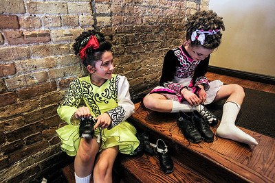 Sarah Nader- snader@shawmedia.com McNulty School of Irish Dance students, Stella Savage (left), 9, of Wauconda and Anna Grace Burns, 10, of Arlington Heights put on their heavy shoes while performing at Duke's Alehouse and Kitchen in Crystal Lake on St. Patrick's Day Monday, March 17, 2014.