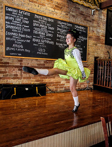 Sarah Nader- snader@shawmedia.com McNulty School of Irish Dance student, Stella Savage, 9, of Wauconda performs  at Duke's Alehouse and Kitchen in Crystal Lake on St. Patrick's Day Monday, March 17, 2014.