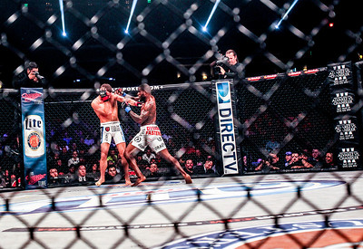 Sarah Nader- snader@shawmedia.com Pat Curran, who trains in Crystal Lake, fights Daniel Straus of Cincinnati during the Bellator MMA 112 featherweight world title at Horseshoe Casino in Hammond Ind. Friday, March 14, 2013.