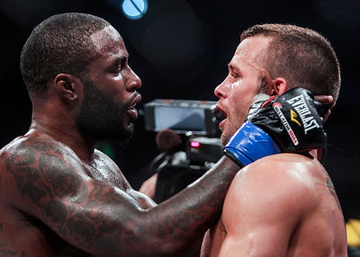 Sarah Nader- snader@shawmedia.com Daniel Straus (left) of Cincinnati congratulates Pat Curran after Curran defeated him in the Bellator MMA 112 featherweight world title bout Friday, March 14, 2014 at Horseshoe Casino in Hammond, Ind.