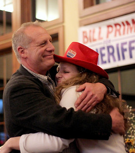 Sarah Nader - snader@shawmedia.com McHenry County Sheriff candidate Bill Prim (left) hugs his daughter, Ellie, 17,  after finding out he won the McHenry County Sheriff election at the Pinecrest Golf Club in Huntley Tuesday, March 18, 2014.