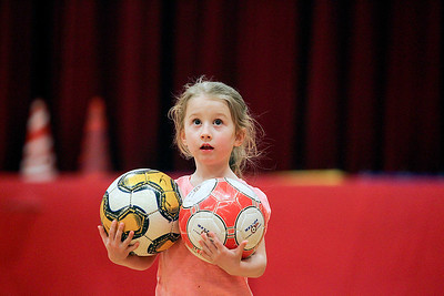 Sarah Nader- snader@shawmedia.com Anna Daleiden, 4, of McHenry runs around the gym picking up soccer balls while attending a McHenry Park and Recreation soccer camp at Chauncey Duker School in McHenry Tuesday, March 18, 2014. To keep kids active and having fun over spring break, the McHenry Parks and Recreation Department is offering a five-day camp. The camp is for children in first through fifth grades and runs from 9 a.m. to 3 p.m. starting Monday.