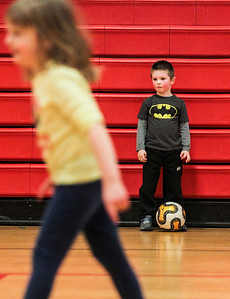 Sarah Nader- snader@shawmedia.com Aidan Mueller, 4, of McHenry practices dribbling while attending a McHenry Park and Recreation soccer camp at Chauncey Duker School in McHenry Tuesday, March 18, 2014. To keep kids active and having fun over spring break, the McHenry Parks and Recreation Department is offering a five-day camp. The camp is for children in first through fifth grades and runs from 9 a.m. to 3 p.m. starting Monday.