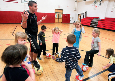 Sarah Nader- snader@shawmedia.com Coach William Klekovic (left) teaches a McHenry Park and Recreation soccer camp for 3 to 6- year-old kids  at Chauncey Duker School in McHenry Tuesday, March 18, 2014. To keep kids active and having fun over spring break, the McHenry Parks and Recreation Department is offering a five-day camp. The camp is for children in first through fifth grades and runs from 9 a.m. to 3 p.m. starting Monday.