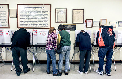 Sarah Nader- snader@shawmedia.com Voting in underway at the American Legion in McHenry Tuesday, March, 18, 2014.