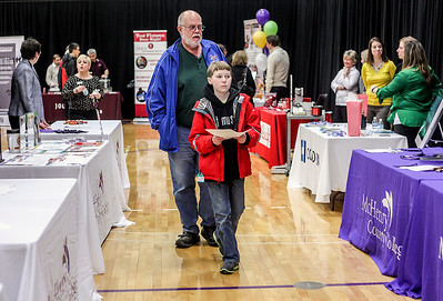 Sarah Nader- snader@shawmedia.com John Retzlaff (left) of Bull Valley and his grandson, Tyler Dobbie, 14, of Bull Valley walk around the Community Career Exploration Showcase at McHenry County College Wednesday, March 19, 2014. The event featured a variety of industries with demonstrations by local business and MCC educational programs. The MCC educational divisions highlighted such industries as manufacturing, engineering, culinary and hospitality, health, public services and business.