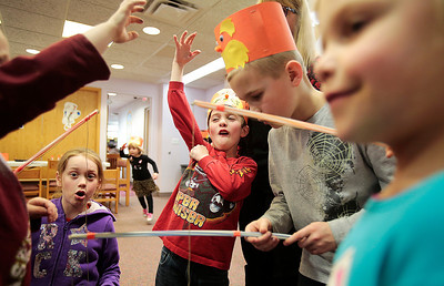 Kyle Grillot - kgrillot@shawmedia.com   Children including Tricia Kennedy, 8, (from left) Lauren James, 5, Kyle Cook, 6, Ben Klein, 8, and Karly Klein fish for Dr. Seuss pictures during Dr. Seuss' 110th Birthday celebration Thursday at the Fox River Grove Memorial Library.