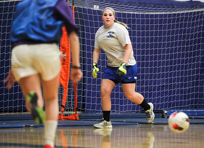 Sarah Nader- snader@shawmedia.com Johnsburg's Emiley Whitlock blocks a goal during soccer practice Thursday, March 20, 2014 at Johnsburg High School. Johnsburg went to state last year and is expecting another good season with a strong freshman class.