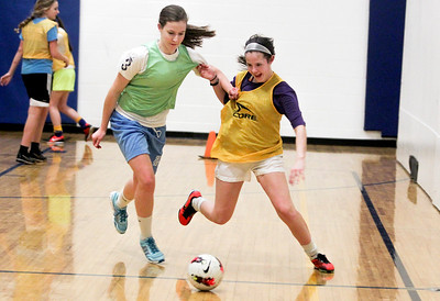 Sarah Nader- snader@shawmedia.com Johsburg's Kayla Toussaint (left) and Delaney Pruitt run after the ball during soccer practice Thursday, March 20, 2014 at Johnsburg High School. Johnsburg went to state last year and is expecting another good season with a strong freshman class.