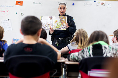 Sarah Nader- snader@shawmedia.com Officer Christina Busby reads a book to a fourth-grade class at Martin Elementary in Lake in the Hills Thursday, March 20, 2014. The school set a new record by utilizing over 80 guest readers throughout the day during Reading Week at the school.