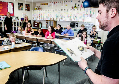 "Sarah Nader- snader@shawmedia.com Ryan Kunde reads, ""Are You My Mother?"" to the fourth-grade class at Martin Elementary in Lake in the Hills Thursday, March 20, 2014. The school set a new record by utilizing over 80 guest readers throughout the day during Reading Week at the school."