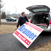 Don Kramer of Geneva takes down a campaign sign near Elgin Wednesday. Kramerwon his primary election for Kane County Sheriff Tuesday against Kevin Williams.
