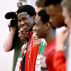 Mooseheart basketball player J.J. Odunsi smiles with his teammates during a celebration that honored the school's athletes Friday morning. Mooseheart won the IHSA Class 1A state basketball title last weekend.