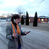 Kane County Board member Melisa Taylor checks her phone while standing outside a Sugar Grove polling place after the polls closed Tuesday night. Taylor lost her bid for re-election to challenger Bill Lenert.