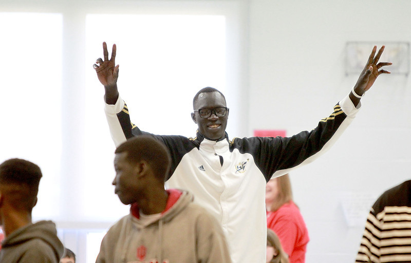 Mooseheart basketball player Makur Puou is introduced during a celebration that honored the school's athletes Friday morning. Mooseheart won the IHSA Class 1A state basketball title last weekend.