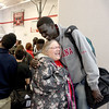 Mooseheart basketball player Mangisto Deng gets a hug from school employee Mary Beth Hake after a celebration that honored the school's athletes Friday morning. Mooseheart won the IHSA Class 1A state basketball title last weekend.