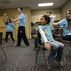 On left, Elburn resident Destiny Hartman, age 11, mimics dance moves in the Wii room with 17-year-old volunteer, on far right, Abby Verfurth, from Batavia, during the Buddy Break monthly event at First Batavia Church March 22.