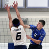 Jeff Krage – For Shaw Media<br /> St. Francis' Greg Churney gets a kill during Wednesday's match against visiting Bartlett.<br /> Wheaton 3/26/14