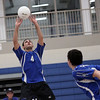 Jeff Krage – For Shaw Media<br /> St. Francis' Robert Smith sets the ball for Dan Zurawski during Wednesday's match against visiting Bartlett.<br /> Wheaton 3/26/14