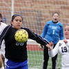 Jeff Krage – For Shaw Media<br /> Geneva's Bre Magpantay attempts to control a corner kick while defended by West Aurora's Yulissa Espino during Saturday's game in Aurora.<br /> Aurora 3/29/14