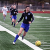 Jeff Krage – For Shaw Media<br /> Geneva's Megan Albrecht brings the ball into the West Aurora end of the field during Saturday's game in Aurora.<br /> Aurora 3/29/14
